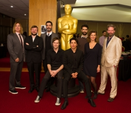 "(left to right): Bryan Buckley, ""Asad""; Tom Van Avermaet, ""Death of a Shadow (Dood van een Schaduw)""; Host Jason Schwartzman; Mino Jarjoura, ""Asad""; Shawn Christensen, ""Curfew""; Yan England, ""Henry""; Ariel Nasr, ""Buzkashi Boys""; Ellen De Waele, ""Death of a Shadow (Dood van een Schaduw)""; and Sam French, ""Buzkashi Boys"".. Credit: Darren Decker / ©A.M.P.A.S."
