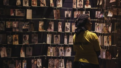A visitor looks at the photo exhibit at the Kigali Genocide Memorial, which documents the 1994 Genocide against the Tutsi population in Rwanda.